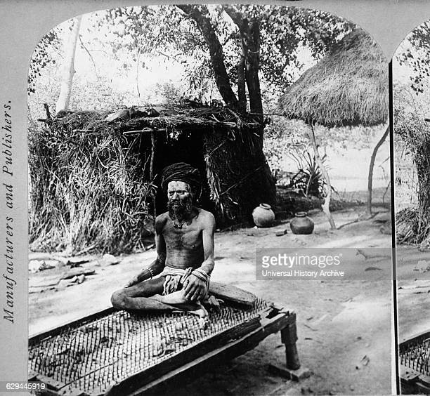 Hindu Fakir Sitting on Bed of Needles India circa 1901