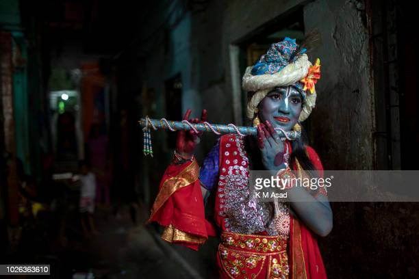 Hindu girl poses for picture takes part in a procession during celebrations Janmashtami or Lord Krishnas Birthday in Dhaka Bangladesh According to...