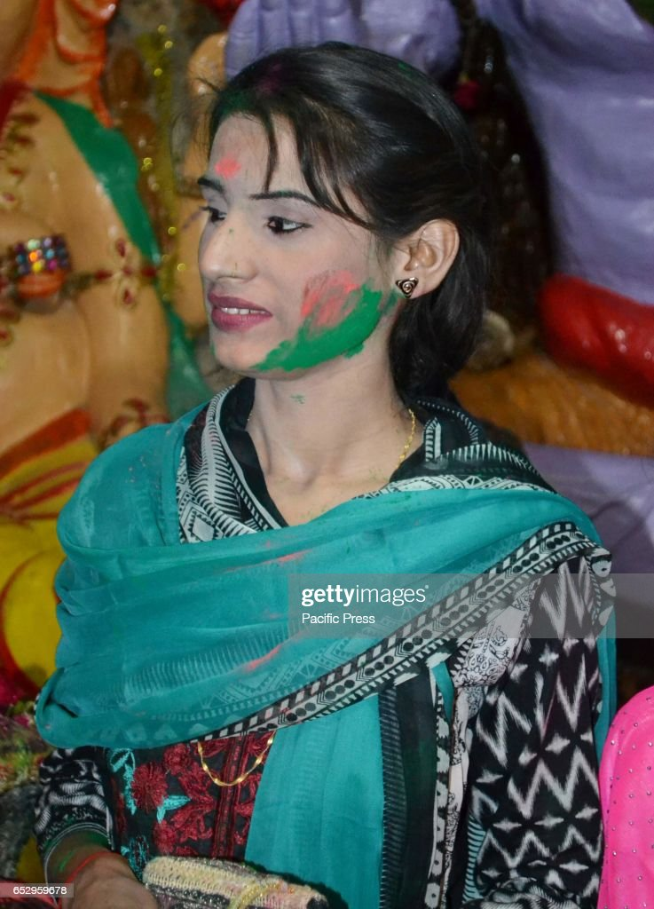 Hindu girl with color on her face take part in the celebration of Holi at a local mandir of Hyderabad.