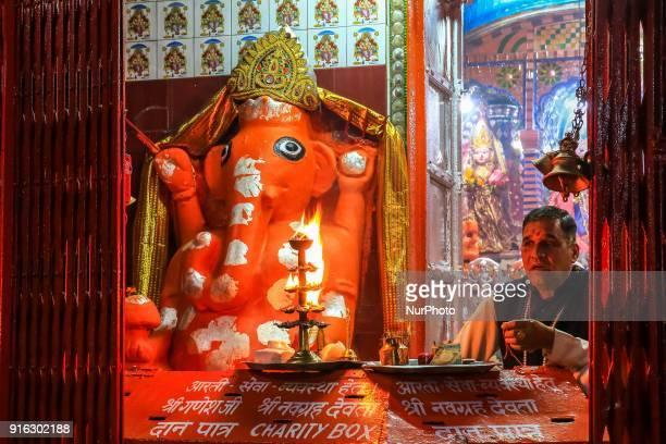 Hindu God Ganesha temple at Har ki Pauri in Haridwar Uttrakhand India on 8th Feb 2018 The priests perform prayers with bowls of fire and the ringing...