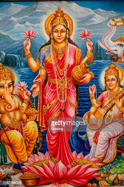 Hindu goddess Lakshmi surrounded by Ganesh and Saraswati Bhaktivedanta manor Watford UK