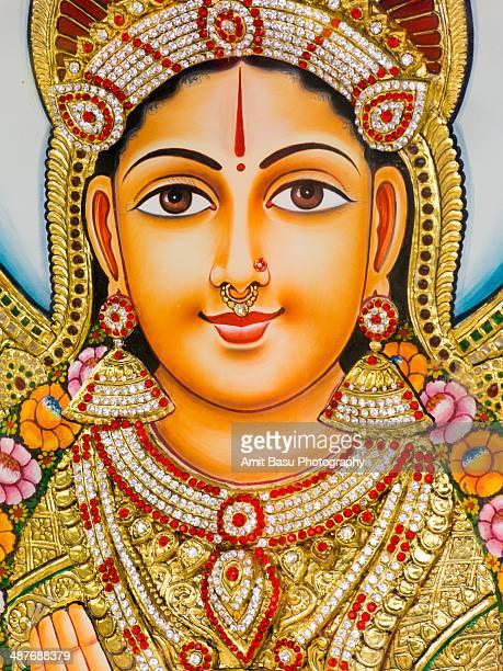hindu goddess laxmi. indian calendar art - goddess lakshmi stock photos and pictures