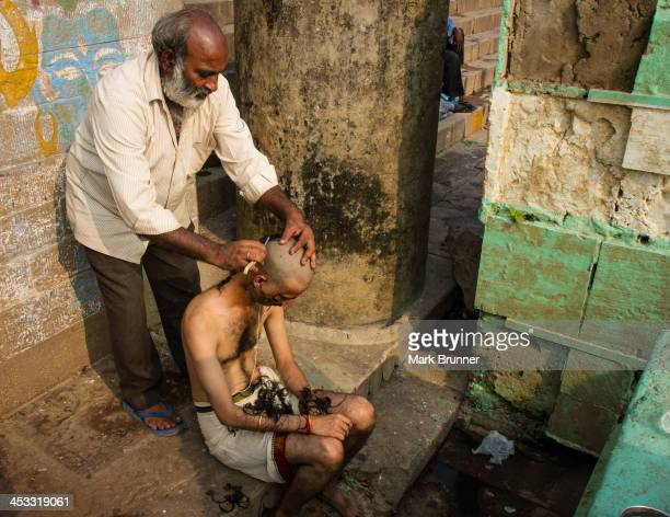 Hindu. Having heads shaved prior to taking a dip in the Ganges river in Varanasi, India. Uttar predesh state. This was during the annual Diwali...