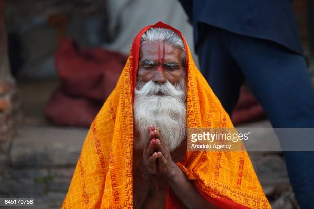 Hindu holy man or sadhu prays at the premises of Pashupatinath Temple during the Maha Shivaratri festival in Kathmandu on Nepal February 24 2017...