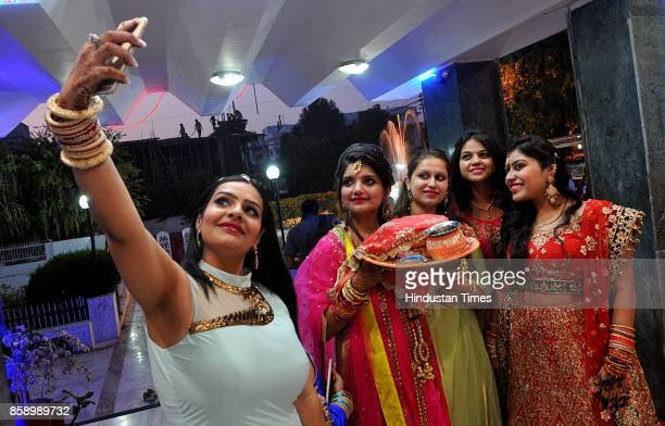 Hindu married women perform rituals during Karva Chauth festival on October 8 2017 in Jammu India Karva Chauth is a oneday festival celebrated by...