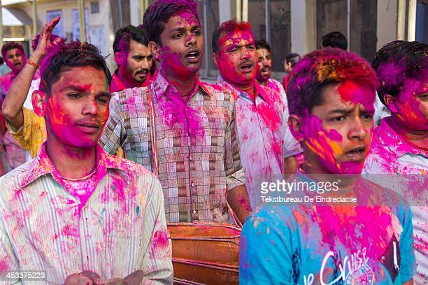CONTENT] Hindu men and boys covered in paint chanting and making music during the colorful Holi festival in Jaipur Rajasthan India