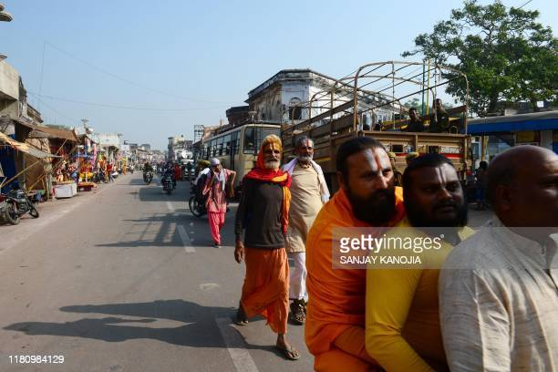 Hindu men make their way along a road in Ayodhya on November 9 ahead of a Supreme Court verdict on the disputed religious site India braced on...