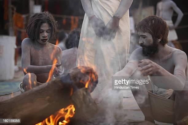 Hindu Naga sadhu belonging to participate in a community feast at Sangam during the Maha Kumbh festival on January 26, 2013 in Allahabad, India....