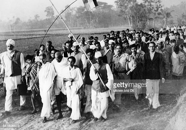 MOHANDAS GANDHI Hindu nationalist and spiritual leader Gandhi accompanied by villagers and workers on a march in West Bengal January 1947