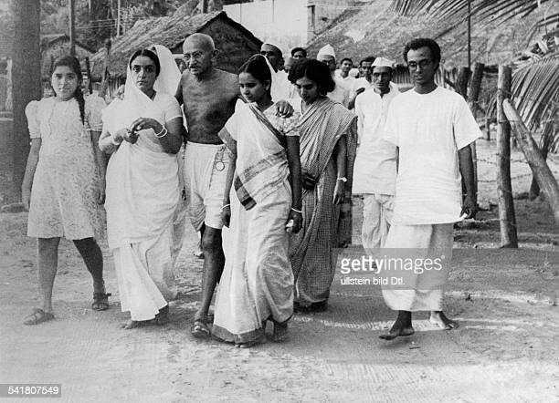 MOHANDAS GANDHI Hindu nationalist and spiritual leader Gandhi on his way to a prayer gathering in Bombay India Photographed in May 1944