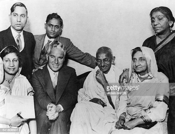 MOHANDAS GANDHI Hindu nationalist and spiritual leader Gandhi photographed in Canning Town London with Charlie Chaplin 22 September 1931