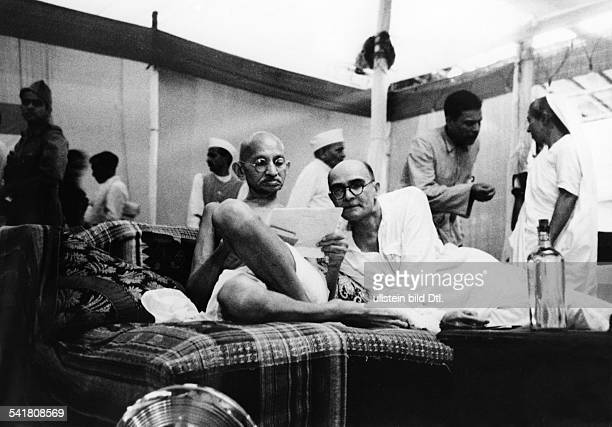 MOHANDAS GANDHI Hindu nationalist and spiritual leader Gandhi with his secretary Mahadev Desai during an assembly of the Indian National Congress in...