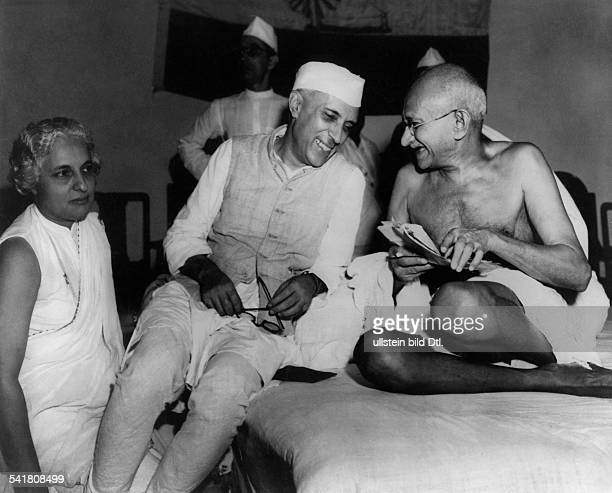 MOHANDAS GANDHI Hindu nationalist and spiritual leader Gandhi with Indian Prime Minister Jawaharlal Nehru during a meeting in Bombay India...