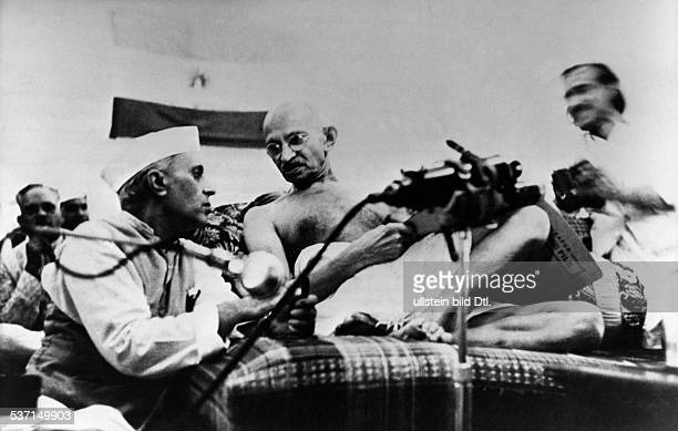 MOHANDAS GANDHI Hindu nationalist and spiritual leader With Jawaharlal Nehru in New Delhi India 1946