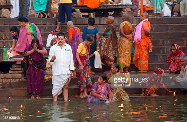 Hindu people by sacred river.