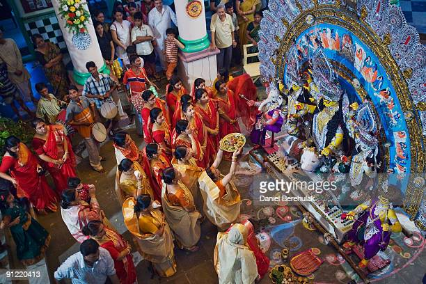 Hindu perform offerings to an idol of the Goddess Durga and her children at a Pandal on the last day of the Durga Puja festival September 28 2009 in...