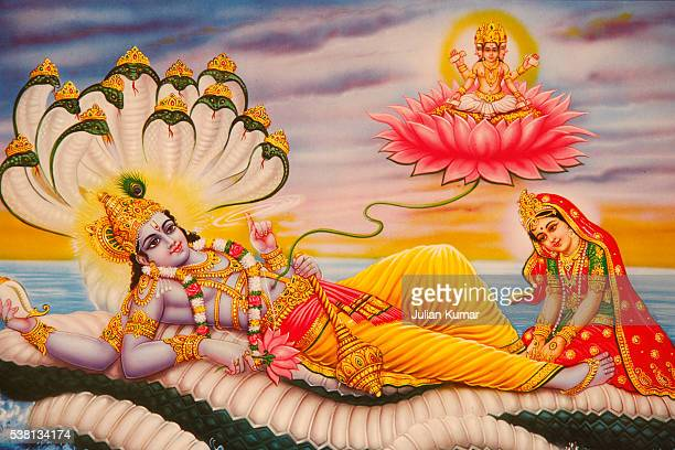 hindu picture depicting the anantashayan or vishnu's cosmic sleep with lakshmi at his feet and brahma coming out from vishnu's navel on a lotus - vishnu stock photos and pictures