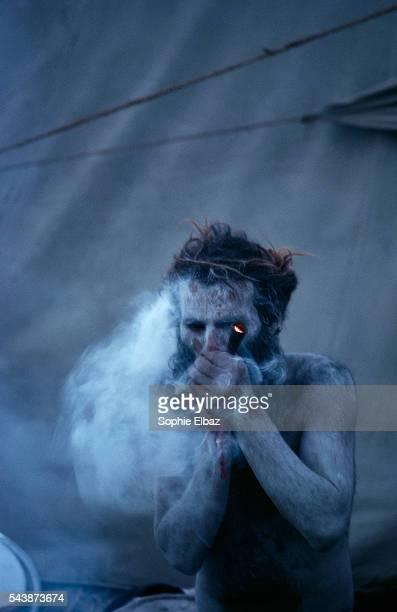A Hindu pilgrim smokes marijuana in Hardwar during the Kumbh Mela festival The Kumbh Mela festival heralds one of the largest human gatherings in the...