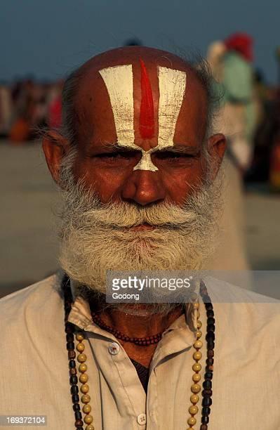Hindu pilgrim with Vishnu symbol on his forehead at Ganga Sagar Mela