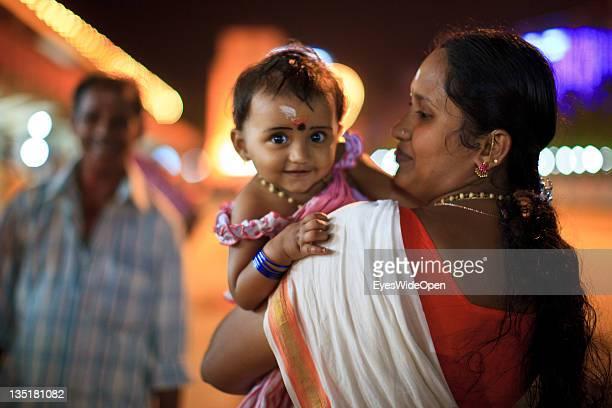 Hindu pilgrims a young girl child with family members visiting the Sri Krishna Temple on December 03 2011 in Guruvayur Kerala India