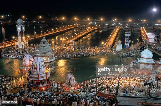 hindu pilgrims bathing during kumbh mela - haridwar stock pictures, royalty-free photos & images