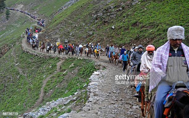 Hindu pilgrims begin their journey from Baltal Base Camp to Srinagar's Amarnath Cave Shrine at 12729 ft altitude on June 21 2009 The annual...