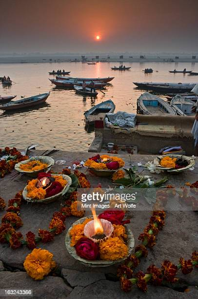 Hindu pilgrims come to Varanasi on the River Ganges to make offerings at the ghats, and swim in the sacred waters.