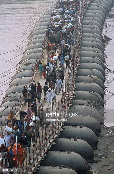 Hindu pilgrims crossing one of the pontoon bridges built to join the Ganges and the Yamuna Rivers to the sacred confluence known as Sangam During the...