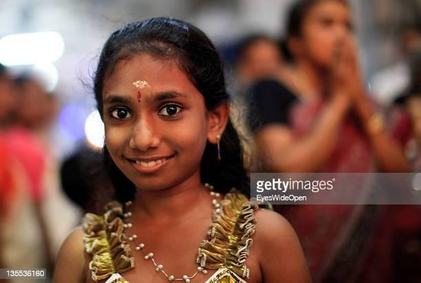 Hindu pilgrims here a beautiful young girl with her family members or relatives visiting the Sri Krishna Temple at December 05 2011 in Guruvayur...