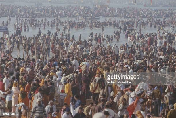 Hindu pilgrims in the river Ganga during Kumbh Mela in Haridwar India 1998