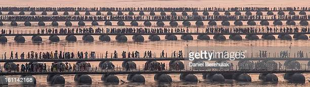 Hindu pilgrims make their way over pontoon bridges near Sangam, the confluence of the holy rivers Ganges, Yamuna and the mythical Saraswati, during...