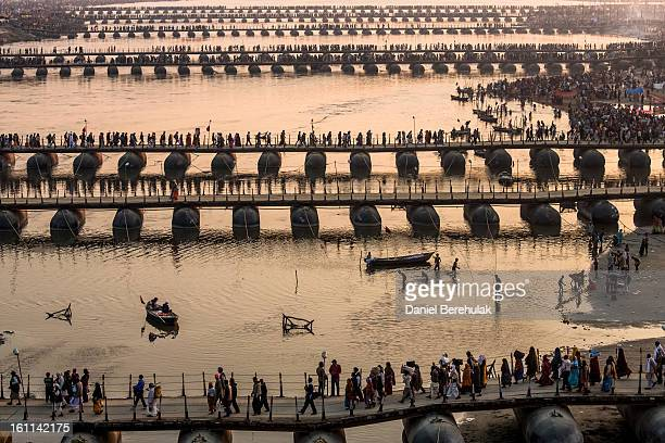 Hindu pilgrims make their way over pontoon bridges near Sangam the confluence of the holy rivers Ganges Yamuna and the mythical Saraswati during the...