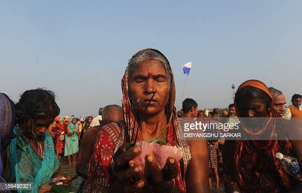 Hindu pilgrims perform rituals after taking a holy dip at Gangasagar some 155 Kms south of Kolkata on January 14 2012 Some four hundred thousands...