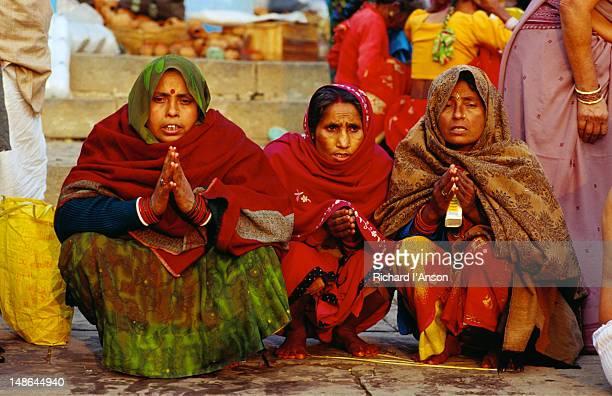 Hindu pilgrims pray on the steps of Dasaswamedh Ghat, Varanasi