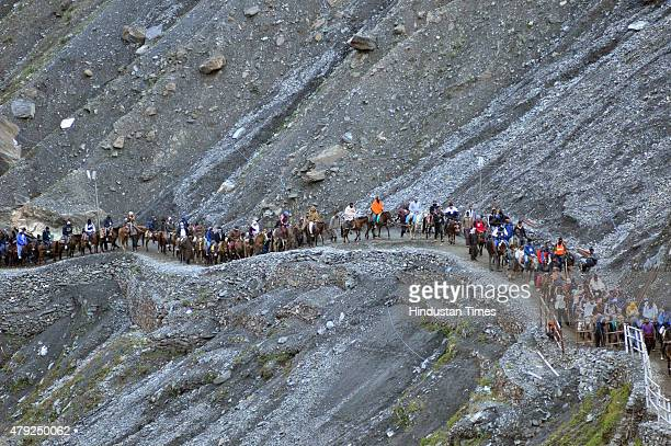 Hindu pilgrims seen on their way to the Amarnath cave on July 2 2015 near Railpathri 125 kilometers northeast of Srinagar India The annual pilgrimage...