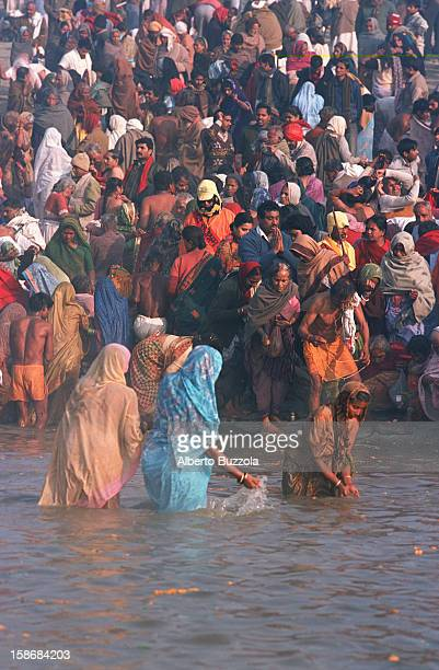 Hindu pilgrims taking a holy bath in the Ganges River..