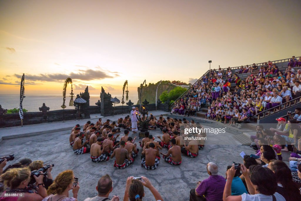 Hindu priest giving blessings to dancers of Fire Dance or 'Kecak' happens in Uluwatu temple every evening, Bali, Indonesia : Stock Photo