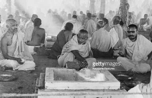 A Hindu priest in the role of firekeeper at a ceremony of prayer for world peace in Mumbai India February 1947 One hundred sacred fires are kept...