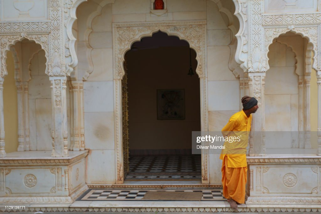 A Hindu priest looking outside : Stock Photo