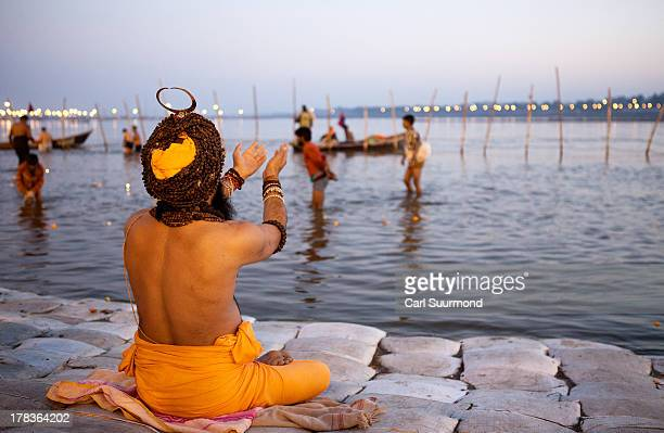 Hindu priest offers prayers on the banks of Triveni Sangam the confluence of the Ganges and Yamuna rivers and the mythical Saraswati River during the...