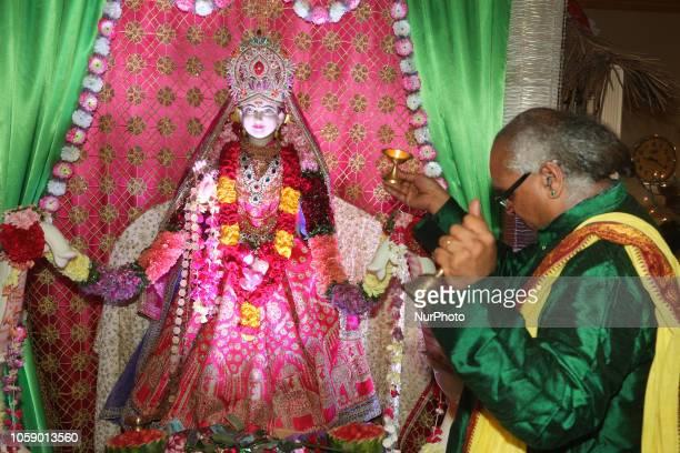 Hindu priest performs Lakshmi puja prayers during the festival of Diwali at a Hindu temple in Toronto Ontario Canada on November 7 2018 Lakshmi is...