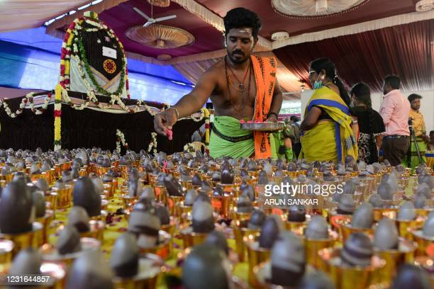 Hindu priest performs rituals on the occasion of the Maha Shivaratri festival in Chennai on March 11, 2021.