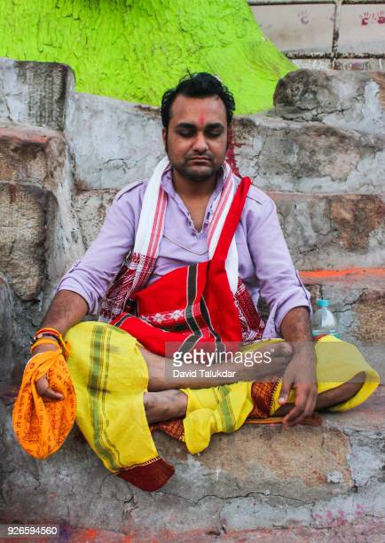 Hindu priest praying at Kamakhya Temple.
