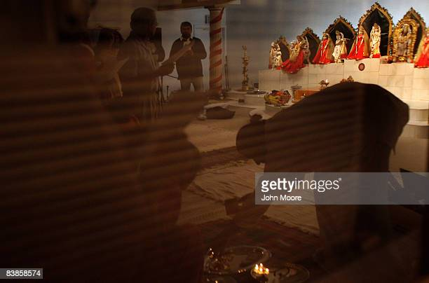 Hindu priest prepares to lead a prayer to mourn those killed in the Mumbai India terrorist attacks while at the Hindu Temple and Cultural Center of...