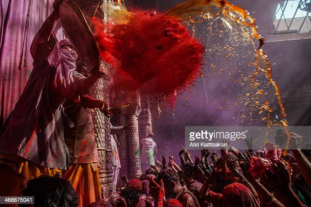 Hindu priest throws coloured powder at devotees during Holi festival at the Banke Bihari temple Known as the festival of colours Holi is an ancient...