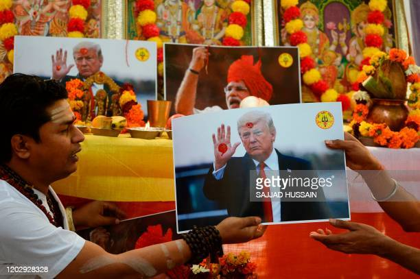 TOPSHOT Hindu priests perform rituals during prayers organised by Hindu Sena a farright Hindu group seeking blessings from gods and to unite India...