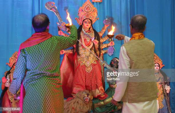 Hindu priests perform special prayers honouring the Goddess Durga during the Durga Puja festival at a pandal in Mississauga Ontario Canada on October...