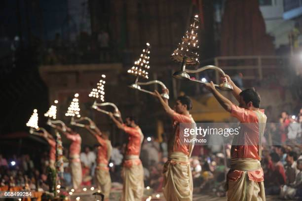 Hindu priests perform the Ganga Aarti ritual in Varanasi Fire puja is a Hindu ritual that takes place at Dashashwamedh Ghat on the banks of the river...