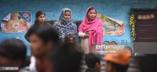 Hindu refugees from Pakistan celebrate after the Citizenship Amendment Bill was passed in Rajya Sabha at Majnu ka Tilla on December 12 2019 in New...