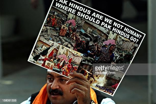 Hindu refugees from Pakistan shout slogans outside the United Nations office during a protest on World Human Rights Day on December 10, 2012 in New...